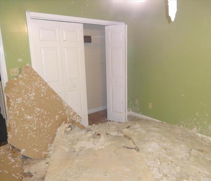 Debris from fallen drywall ceiling and insulation